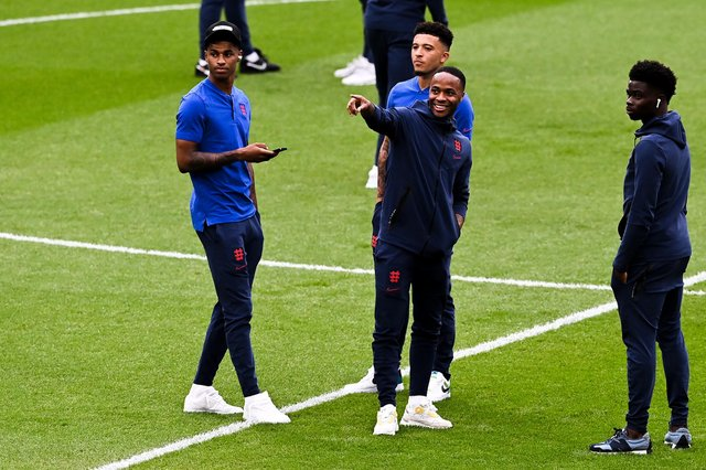 Marcus Rashford, Raheem Sterling, Jadon Sancho and Bukayo Saka of England speak during a pitch inspection prior to the Euro 2020 final (Photo by Facundo Arrizabalaga - Pool/Getty Images)