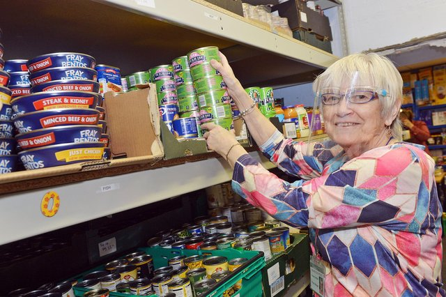 Yvonne Campbell  checks stock at Hucknall food bank, which is restarting the Hucknall Donates scheme