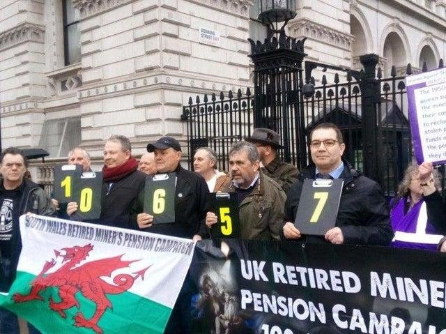 Former mineworkers outside Downing Street in 2019 after handing in a 100,000-strong petition calling for a fairer pension deal.