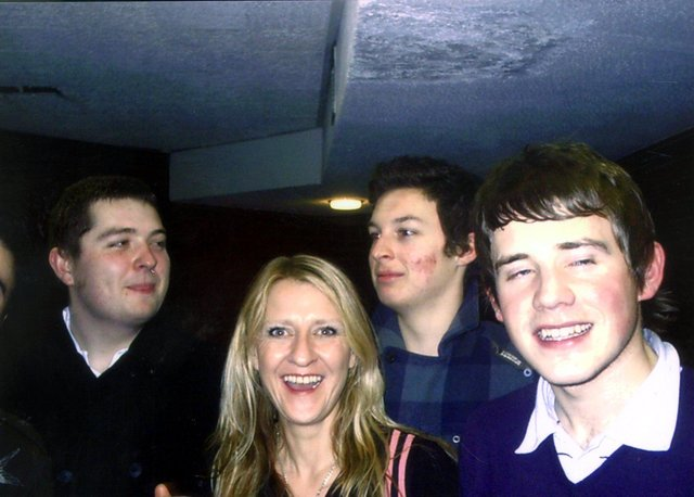 Jaqui Dowling with Arctic Monkeys Andy Nicholson, Matt Helders and Jamie Cook.
