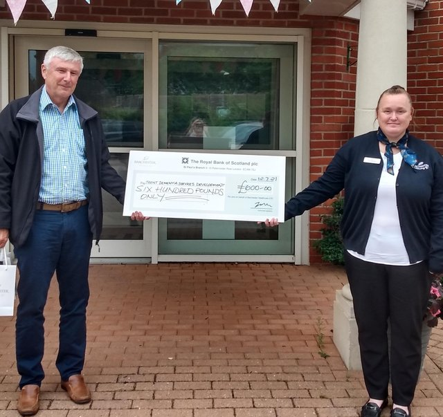 Pictured is Tom Dening from Trent Dementia Services Development and Lisa Moore, deputy home manager at the cheque presentation.