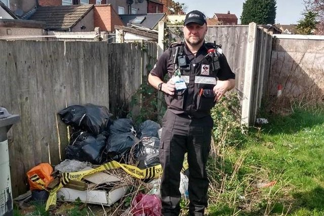 One of Ashfield District Council's community protection officers with fly-tipped waste on Beardall Street