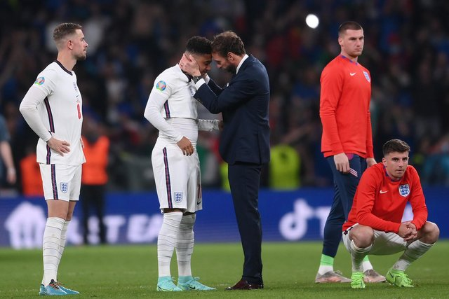 Gareth Southgate consoles Jadon Sancho after the penalties defeat to Italy.
