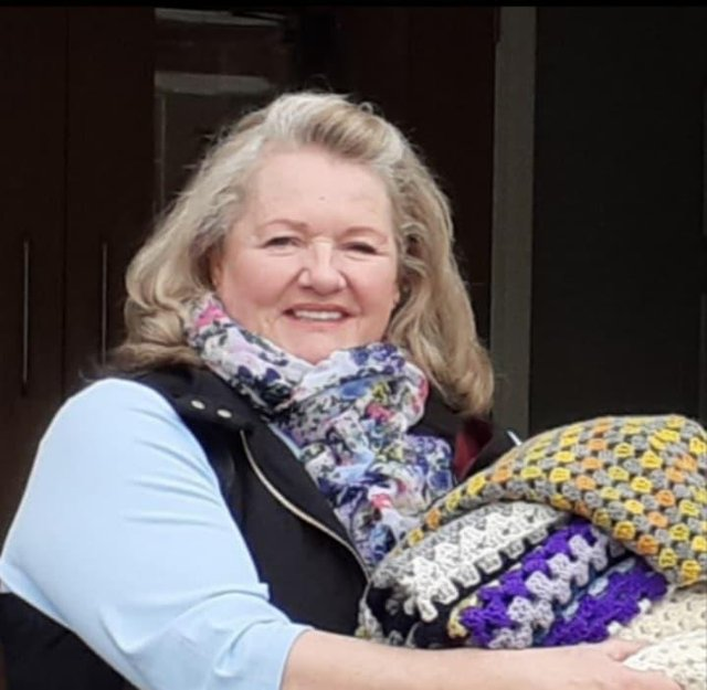 Jan Lees and her knitters and crocheters have made blankets for the brain injury unit