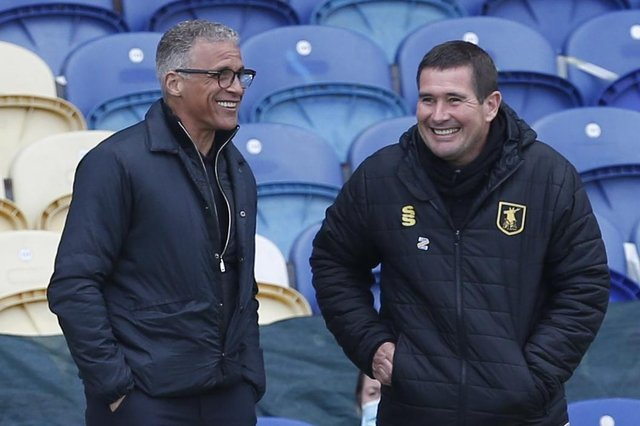 Keith Curle is all smiles with Nigel Clough pre-match on Saturday, but those smiles were long gone after seeing his side torn apart by his old club.