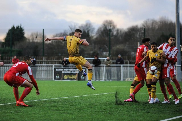 Defender Stef Galinksi heads home Basford United's opener in their FA Trophy win over Felixstowe and Walton United at Greenwich Avenue on Saturday afternoon (CREDIT: Craig Lamont)