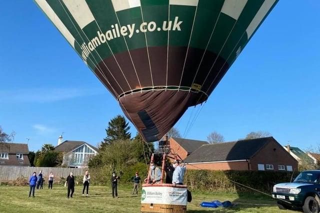 Nottingham & Derby Hot Air Balloon Club's balloon prepares for take off. Photos: Robin Macey