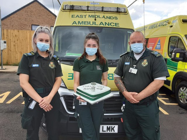 Ambulance staff with their cake
