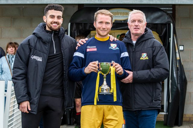 Basford United's captain Matt Thornhill post-game with cup sponsor William Munroe (left) and Club Vice President Stan Mitchell (IMAGE: Craig Lamont Photography)