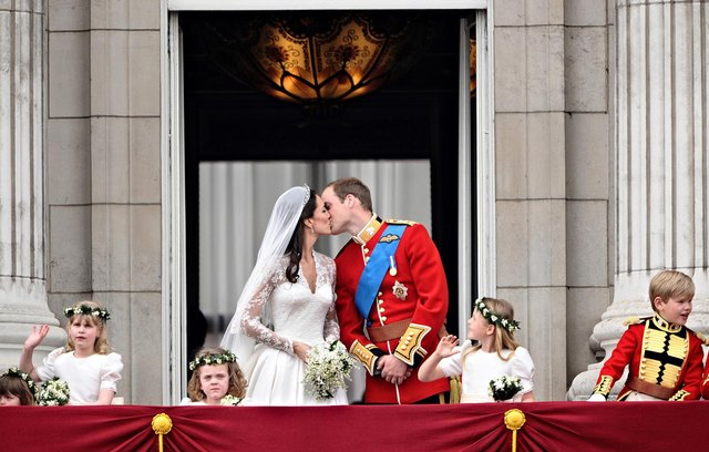 The Duke and Duchess of Cambridge share a kiss on the balcony at Buckingham Palace after their wedding 10 years ago. Photo: Leon Neal/AFP/Getty Images
