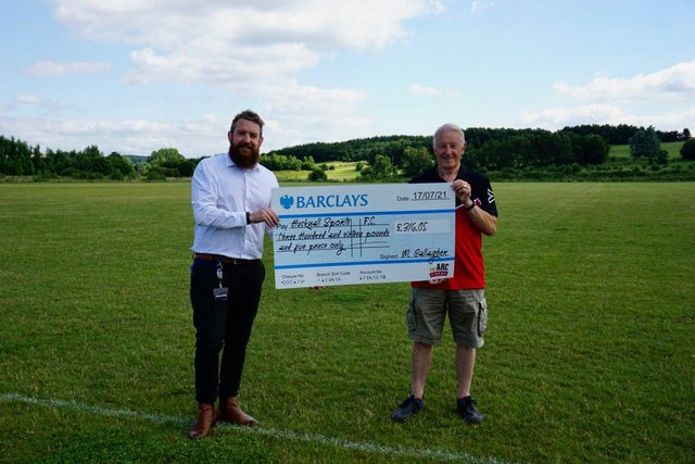 Mark allagher, of The Arc, presents the cheque to Sports