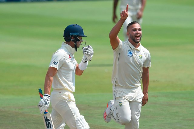 Dane Paterson celebrates after the dismissal of Joe Denly (L) during the fourth Test against in January. (Photo by Christiaan Kotze / AFP) (Photo by CHRISTIAAN KOTZE/AFP via Getty Images)