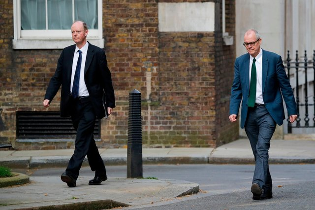 Chief Medical Officer Chris Whitty (L) with Britain's Chief Scientific Adviser Patrick Vallance (R) who will head up the Vaccine Taskforce. (Photo by Tolga AKMEN / AFP) (Photo by TOLGA AKMEN/AFP via Getty Images)
