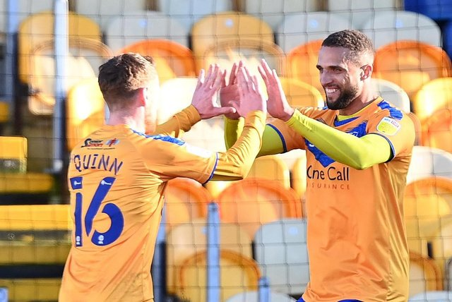 Mansfield's Jordan Bowery celebrates a goal with Stephen Quinn last season.