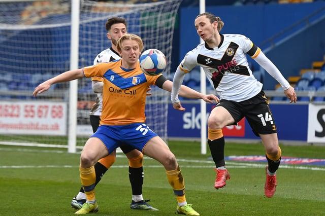 Mansfield's George Lapslie battles with Newport's Aaron Lewis.