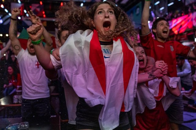 England fans cheer during the semi-final match between England and Denmark (Photo by Dan Kitwood/Getty Images)