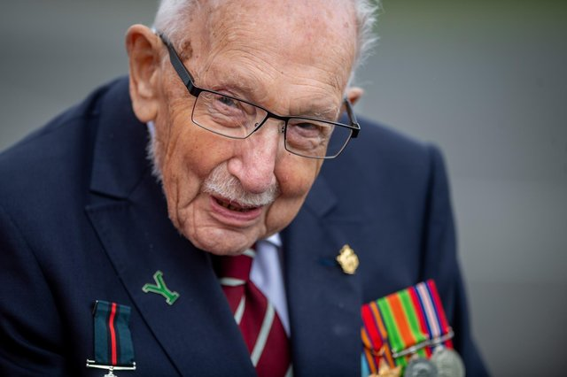 Captain Sir Tom Moore, seen visiting the Army Foundation College, Harrogate, has tested positive for Covid, his family say.