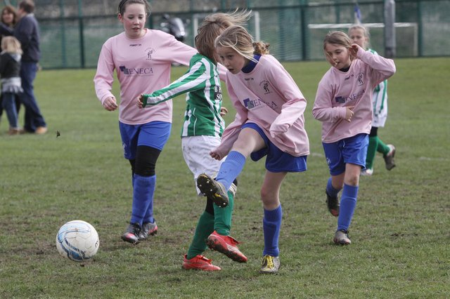 Kids can mix in school but not on the football pitches away from school.