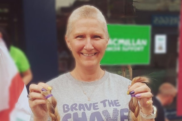Hucknall woman Maxine Lewis shows off her former locks after having her head shaved for charity.