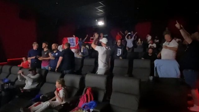 England fans celebrate beating Germany after watching the game at the Arc Cinema