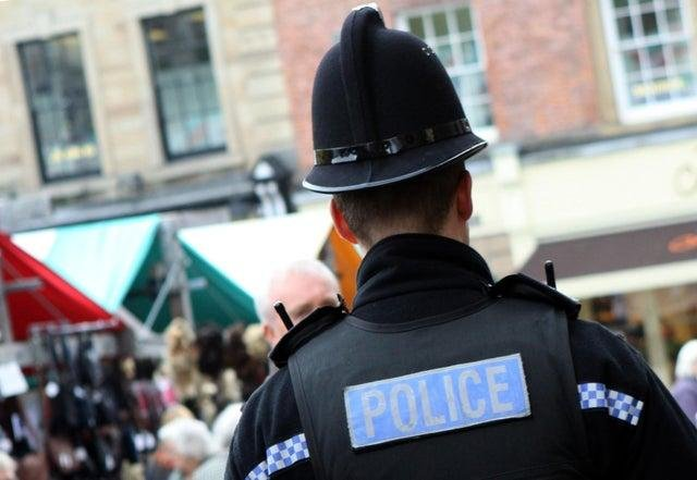 Police called to address after man has been charged after an alleged brick attack