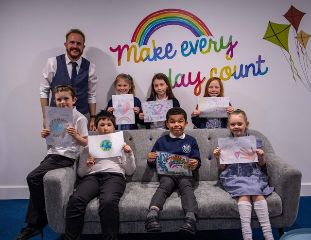 Head teacher Karl Clowery with children and their designs concerning courage and friendship inspired by Stephen Lawrence Day. Photo: Lou Brimble