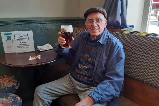 Ken Willett raises a glass to being back in his usual seat in the Red Lion