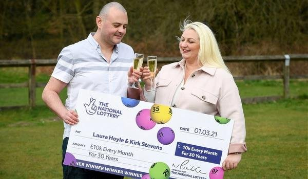 Laura Hoyle and Kirk Stevens have won £10,000 a month for the next 30 years. Photo: SWNS