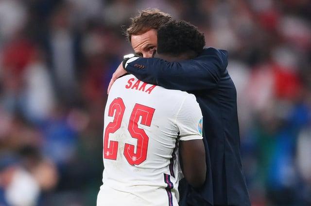 Bukayo Saka is consoled by Gareth Southgate.