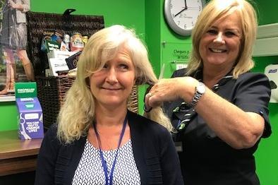 Maxine Lewis (left) gets a 'dress rehearsal' cut from fellow Hucknall branch colleague Helen Beale